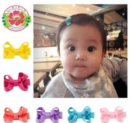 Wholesale Hair Clips Wholesalers Japan - Children bowknot hairpin Han edition girls hair accessories Pure color edge clip accessories Japan and South Korea credit card