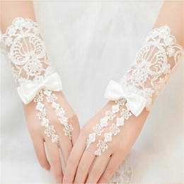Wholesale Glove Bow - 2017 New Short Bridal Gloves with Bow Free Size Romantic Wedding Gloves for Wedding Dress Elegant White Ivory Princess Wedding Accessories