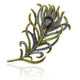 Wholesale BEAUTIFUL EMERALD AB CRYSTAL RHINESTONE BROOCHES PEACOCK FEATHER WEDDING PARTY PIN BROOCH styles can be choices