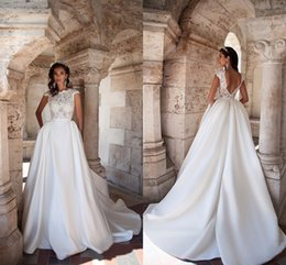 Wholesale Long Sleeve Dress Top Models - Elegant 2017 New Cap Sleeves Lace Top Wedding Dresses Satin Ball Gown Sexy Backless Bridal Gowns Long Train With Pockets Wedding Gowns