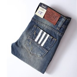 Wholesale High Quality Denim Jeans - Wholesale- 2017 High Quality White Button Jeans Men New Famous Brand Dsel Jeans Ripped Trousers Slim Denim Classic Blue Mens Jeans T9003