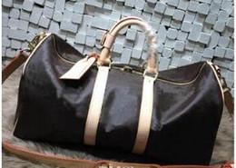 Wholesale Large Clear Handbags - 54CM new fashion men women travel bag duffle bag, brand designer luggage handbags large capacity sport bag with lock