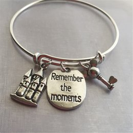 """Wholesale Stamps Keys - 12pcs Bracelet with castle mouse key and stamped """"remember the moments"""""""