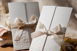 Wholesale Tri Folding Invitations - Wholesale- 50pcs lot Wedding Invitation Vintage Embossed Tri-fold With Ribbon Bow marriage invitation card Convite Casamento Party Supplies