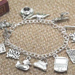 Wholesale Duck Charm Bracelets - 12pcs FRIENDS inspired bracelet Coffee Cup Dinosaur Sofa Broom Cat pizza Fairy Duck bracelet