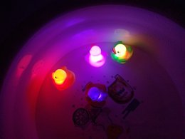 Wholesale Induction Lighting Free Shipping - The new hot light floating duck duck induction flash baby shower emitting children's toys or SF EXPRESS DHL free shipping