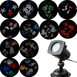 Wholesale Halloween Uk - Christmas Projector Lamp 12 Replaceable Lens 12 Colorful Patterns Night Lamp Halloween Birthday Wedding Decoration LED Outdoor laser Lamp