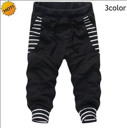 Pantalones holgados de jersey online-Moda HIp Hop Diseño de la raya del bolsillo grande Haz de pie Pantalones Bermuda Masculina Drawstring Street Baggy Harem Pantalones Pantalones cortos