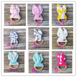 Wholesale Neonatal Baby - Baby toothbrush, wooden ring, hand ringing bell, natural wood circle and rabbit ear fabric neonatal teeth practice toys