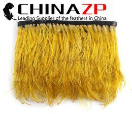 Argentina Profesional Al Por Mayor CHINAZP 10 yardas / lote 5 cm Especial Amarillo Golden Faisán Feather Trim for Skirt Dress Costume Suministro