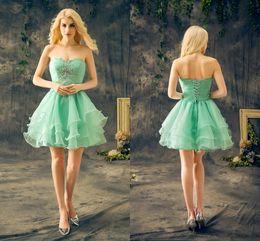 6d9a2a4088 Vestidos de fiesta corto verde menta Sweetheart sin mangas con cuentas de  cristal Ruffles gasa baratos vestidos de cóctel reales cheap mint green  sleeveless ...