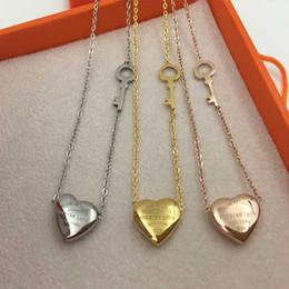 Colliers coeur amour pour toujours en Ligne-Collier à clés en coeur titane à l'honneur Collier à clés en forme de coeur en or rose 18 carats
