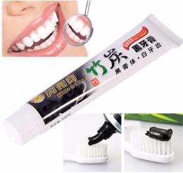 creme dental de carvão de bambu Desconto pasta de dente de carvão creme de clareamento pasta de dente preto de bambu creme dental pasta de dente pasta de dente de higiene oral 100g KKA2007
