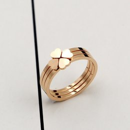 Wholesale One Piece Combination - Han's three-in-one combination of the four-leaf clover titanium rose gold ring, and the three-piece ring for women's heart
