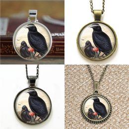 Foto di corvo online-10pcs corvo vittoriano uccello vittoriano uccelli 28 vetro foto cabochon collana portachiavi segnalibro gemello braccialetto orecchino