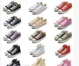 2019 чистая кожа низкой повседневной обуви Новый звезда большой размер 35-45 высокий топ Повседневная обувь низкий топ стиль спортивные звезды Чак классический холст обувь кроссовки мужская / женская холст обувь