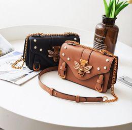 Wholesale wild fashion bags - Promotional Hot Sale Designer handbags 2018 new personality wild rivets small square bag fashion shoulder Messenger bag leisure bag