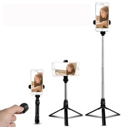 2019 selfie stick bluetooth inalámbrico plegable Nuevo trípode plegable Monopod Selfie Stick Bluetooth con botón inalámbrico Obturador Selfie Stick para Samsung iPhone selfie stick bluetooth inalámbrico plegable baratos