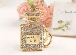 Wholesale perfume gift bags - crystal N5 perfume bottle keychains women bags pendants key chain key rings fashion statement jewelry Christmas gift J107