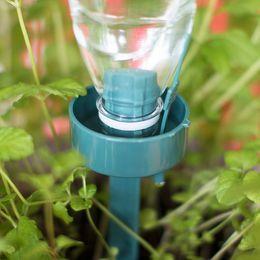 Bottiglia d'irrigazione online-Dispositivo di irrigazione automatico Eco Friendly Risparmio di acqua Coca Cola Sprinkler Waterer Drip Fiori Piante Forniture da giardino 2 2 gg gg