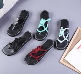 55e3cd26cd6 Sandalias de mujer de lino tejidas a mano sandalias planas sandalias  sandalias sandalias versátiles sandalias de dedo de playa cruzadas simples  DDA629 ...