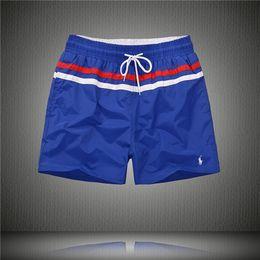 Estilo de praia para homens on-line-Nova Moda Mens Shorts Casuais Cor Sólida Board Shorts Homens Verão estilo Praia Calções De Natação Homens Esportes Curto