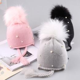 Cappello di lana del bambino online-New Toddler Baby Knit Hat Pearl Cap Bambini Baby Boy Girl Infant Cotton Ball Earbud Hat Caldo caldo berretto di lana infant 1-3 anni