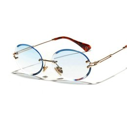 Diamond Cut Retro Oval Gafas de sol Mujer Cristal Gafas texturadas Sin bordes JW desde fabricantes