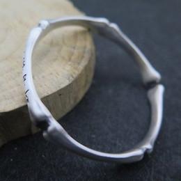 Штраф реального S999 стерлингового серебра браслет манжеты женщины мужчины резные кости браслет 30.8 г supplier fine bone от Поставщики fine bone
