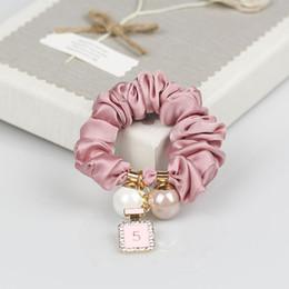 Botella de goma online-CC Perlas anillos para el cabello cuerdas para el cabello botella de perfume colgante simple banda de goma tocado adornos para el cabello contador regalos