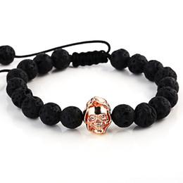 roségold schädel armband Rabatt Marke Trendy Natürliche Perlen Strang Armband Rose Gold Skeleton Schädel Schwarz Lava Rock Stein Energie Männer Europäischen Buddha Schmuck
