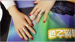 Argentina Nueva moda 2019 Cool Gold Metal Stack Skull Bow joyería nupcial Nail Band medio dedo superior anillo conjunto alta calidad anillos cheap metal nail rings Suministro