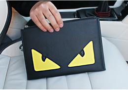 Grandes monederos negros online-Nueva alta calidad de gran tamaño 28 cm para hombre ojos dobles monstruo negro carteras de diseño casual masculina cero monederos de moda embragues no103
