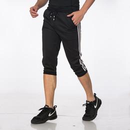Pantalones de entrenamiento de fútbol masculino / femenino Pantalones de fútbol Pantalones de fútbol recortados Pantalón 3/4 Hombres Deportes Correr Fitness Pantalones de chándal delgados desde fabricantes