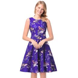 tissu vintage à imprimé floral Promotion Robe de mode printemps nouvelle robe de caractère A Hepburn vintage imprimé jupe de loisirs professionnel sans manches