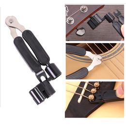 2019 violão de cordas 3 em 1 Multifuncional Guitar Acessórios Guitarra Corda Enrolador + String Pin Extrator + String Cutter NY052 violão de cordas barato