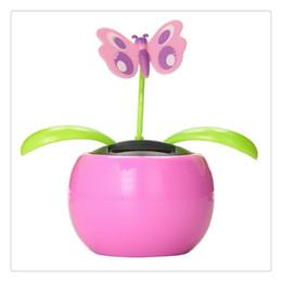 Commercio all'ingrosso Decorazione auto Solar Power Swing automatico Apple Flowerpot Moving Dancing Butterfly Car Toy Interessante di alta qualità da