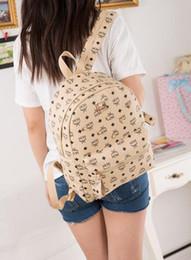 Vente chaude rivets sac à dos cartable casual sac à main sac à bandoulière étudiant fille sac cartable sac de voyage de champ ? partir de fabricateur