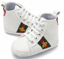 Argentina NUEVOS bebés niños niñas suela blanda zapatos de cuero de la PU zapatos antideslizantes zapatillas de deporte del niño 0-18M. Envío gratis Suministro