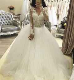vestido de corpiño de cristal Rebajas Vestidos de novia de encaje de manga larga Una línea de abalorios apliques de cristal Ilusión Blusa Sheer Plus Size vestidos de novia