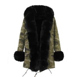 Щедрые меха jazzevar Марка женщины зимние пальто Черная лиса и кролик меховая подкладка камуфляж оболочки длинные парки черный енот меховой отделкой cheap fox fur trimmed coat от Поставщики меховое пальто из лисы