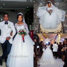 Robes de mariée chine en Ligne-Nigeria robes de mariée une ligne Illusion manches longues Sheer Neck Tulle Sweep Train robes de mariée élégantes pour la mariée 2018 Custom Made in China