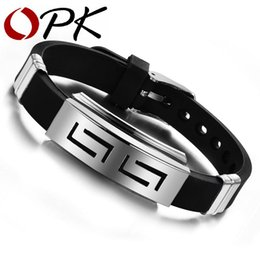 Wholesale Opk Jewelry - Wholesale- OPK JEWELRY Free Shipping Wholesale Fashion jewelry Silicone Rubber Silver Slippy Hollow Strip G Grain Stainless Steel Bracelet