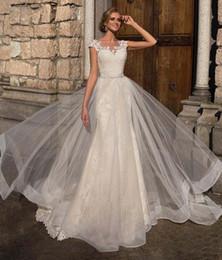 Wholesale Peplum Wedding Dresses - Elegant 2018 Lace Appliqued Mermaid Wedding Dresses With Peplum Cap Sleeves Sheer Scoop Neck Long Wedding Gowns Church