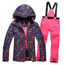 d48002769b322 Kış bayanlar profesyonel kayak giyim sıcak kayak ceket rüzgar geçirmez su  geçirmez aşınmaya dayanıklı kar ceket + önlük pantolon