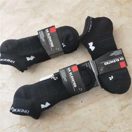 Argentina Hombres Mujeres Marca UA Calcetines de tobillo Algodón de punto Zapatillas Unisex Terry Tobillera Armadura Negro Calcetines Deportes Cortos Calcetines Suministro