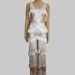 Pantalón blanco flare online-Traje atractivo para mujer Desfile de bar Desempeño en la etapa desgaste Borlas blancas mono Pantalón flare baile cantante bailarina espectáculo