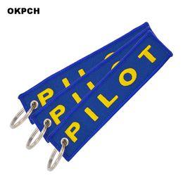 schlüsselketten etiketten Rabatt Pilot Key Chain Stickerei Blue Key Label Gepäck Sicherheitsetikett Luftfahrt Geschenke
