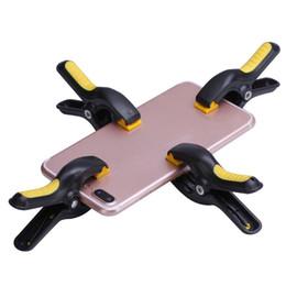 Canada 4pcs / lot Clip de fixation pour écran LCD en plastique Clip de fixation pour Iphone Samsung iPad Tablet Kit de réparation de téléphone cellulaire cheap ipad repair kits Offre