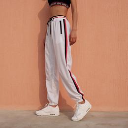 Pantaloni felpa elastica alla caviglia online-Pantaloni a vita alta alla moda Pantaloni della tuta patchwork laterali Pantaloni casual a vita elastica da donna Pantaloni primavera 2018 Pantaloni alla caviglia